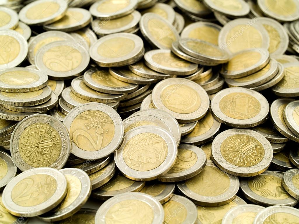 1432287-Female-hands-grabbing-shiny-coins--Stock-Photo