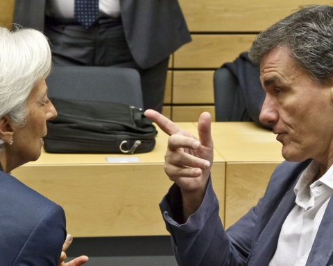 Greek Finance Minister Euclid Tsakalotos, right, speaks with Managing Director of the International Monetary Fund Christine Lagarde during a round table meeting of eurogroup finance ministers at the EU Lex building in Brussels on Sunday, July 12, 2015. Greece has another chance Sunday to convince skeptical European creditors that it can be trusted to enact wide-ranging economic reforms which would safeguard its future in the common euro currency. (AP Photo/Michel Euler)
