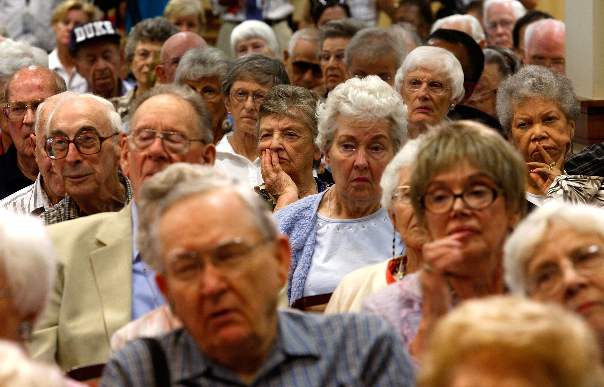SPRINGFIELD, VA - AUGUST 25:  Residents listen during a health care forum at Greenspring Retirement Community August 25, 2009 in Springfield, Virginia. Congressional members from across the country have returned to their own district to listen to voters' opinions on healthcare reform.  (Photo by Alex Wong/Getty Images)