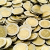 1432287-Female-hands-grabbing-shiny-coins--Stock-Photo